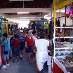 Tourists Shopping In The Amina Market