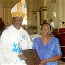 Eileen Grey Receives Award From Bishop Gabriel Malzaire