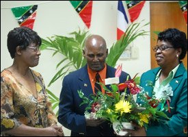 Pastor Cecil Maynard-Hodge Receives Bouquet