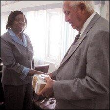 Mr. Charles Brisbane Presents Handcuffs