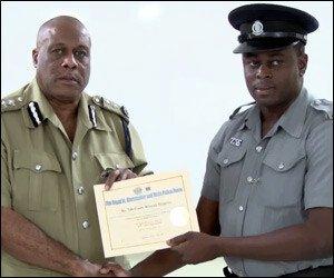 Police Commissioner Liburd and PC Huggins