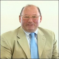 Commissioner Mr. Thomas Sharpe QC