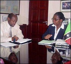 PM Douglas - and Financial Secretary Harris (r)<br>