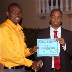 Dr. Ron Carty Receives Certificate From Dr. Dwain Archibald