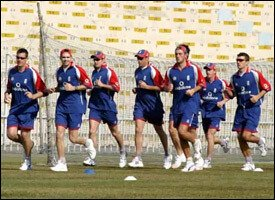 Members Of The English Cricket Team Warming Up