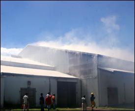 Smoke Billowing From Ram's Supermarket