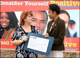 Kathryn Wyatt of Huuricane Cove Bungalows Donates To HIV/AIDS Program