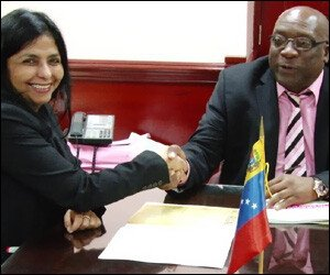 Minister Gomez with PM Harris