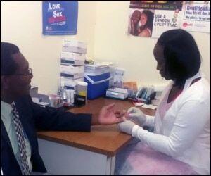 Minister Hamilton Takes AIDS Test