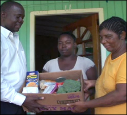 Minister Hector Hands Over Donated Food To Imelda Clarke