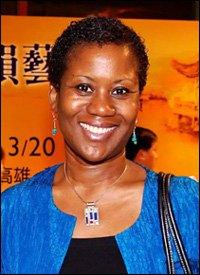 Ms. Jasmine Elise Huggins - Charge d'Affaires