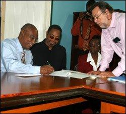 Premier Parry Signs Civil Servants Housing Aid Agreement