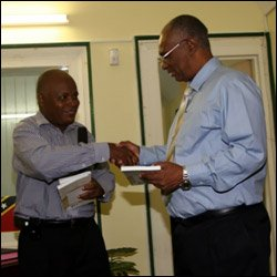 Book About Nevis' History Presented to Premier Parry