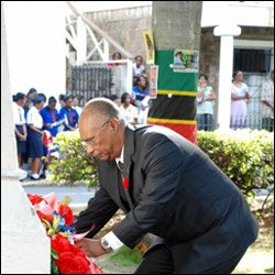 Nevis Premier Laying Memorial Wreaths