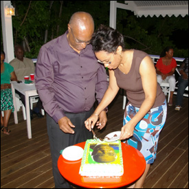 Premier Parry Cuts His Birthday Cake