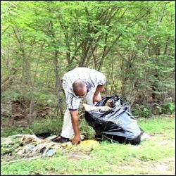 Nevis Premier Picks Up Trash