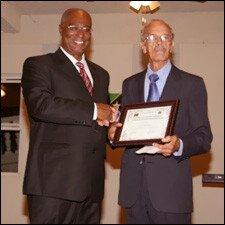 Premier Parry Presents Award To Arthur Evelyn