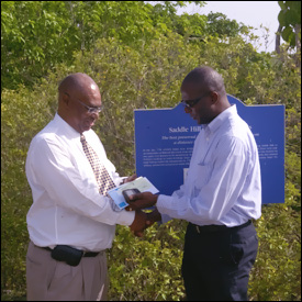 Premier Parry Accepts Check From SIDF