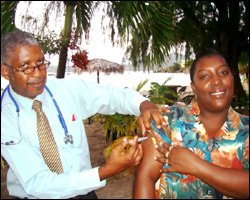 Dr. Liburd Administers Vaccine Shot To GM Faith Bertie