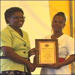 Patricia Hanley Gives Award To Donna Hanley