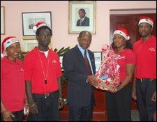 PM Douglas Accepts Gift From YES Participants