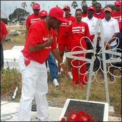 PM Douglas Lays Wreath At Bradshaw Grave