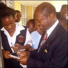 PM Douglas Signs Autographs For CSS Students