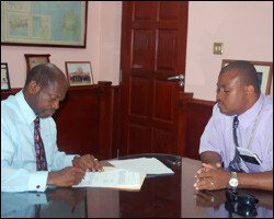PM Douglas Signs Code of Conduct