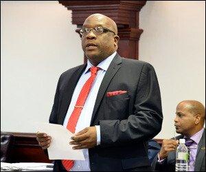 PM Harris Announces Banking Settlement