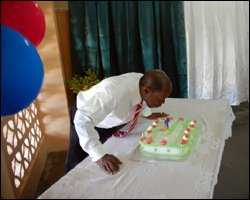 Prime Minister Douglas Blows Out Candles