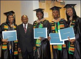 Recent UVI Graduates With PM Douglas