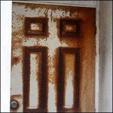 Rusty Door At Gardens Housing Complex