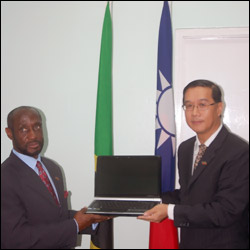 Sam Condor Receiving One Of The Laptops From Miguel Li-Jey Tsao