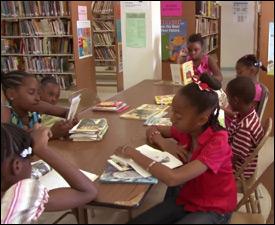 Students Enjoying A Good Book