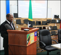 PM Douglas Surrounded by 2,400 Laptops