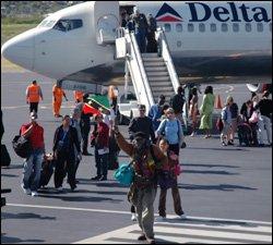 Passengers Arrive In St. Kitts On Delta Flight