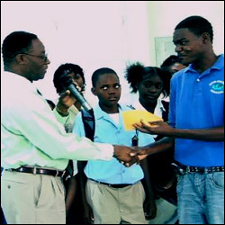 Michael Webbe Shakes Hands On Donation