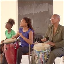 Female Drummers Enjoying The Rhythm