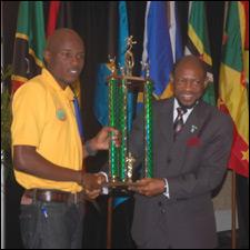 Zepherinus Joseph Receives Trophy From PM Douglas